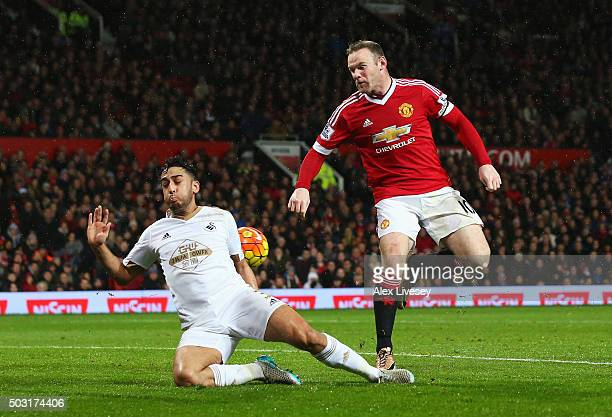 Wayne Rooney of Manchester United scores his team's second goal during the Barclays Premier League match between Manchester United and Swansea City...