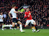 Wayne Rooney of Manchester United scores his team's third goal as Jan Vertonghen of Spurs closes in during the Barclays Premier League match between...