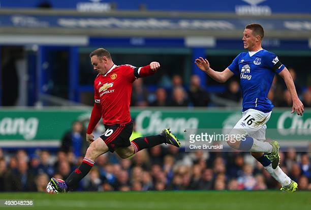 Wayne Rooney of Manchester United scores his team's third goal during the Barclays Premier League match between Everton and Manchester United at...