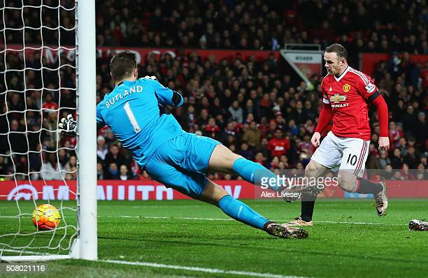 Wayne Rooney of Manchester United scores his team's third goal past Jack Butland of Stoke City during the Barclays Premier League match between...