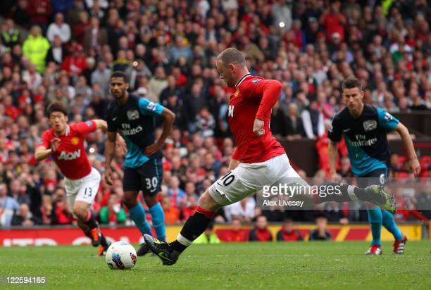 Wayne Rooney of Manchester United scores his third goal from the penalty spot during the Barclays Premier League match between Manchester United and...