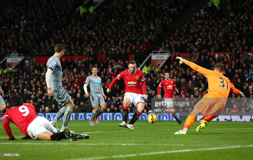 Wayne Rooney of Manchester United scores the first goal during the Barclays Premier League match between Manchester United and Newcastle United at Old Trafford on December 26, 2014 in Manchester, England.