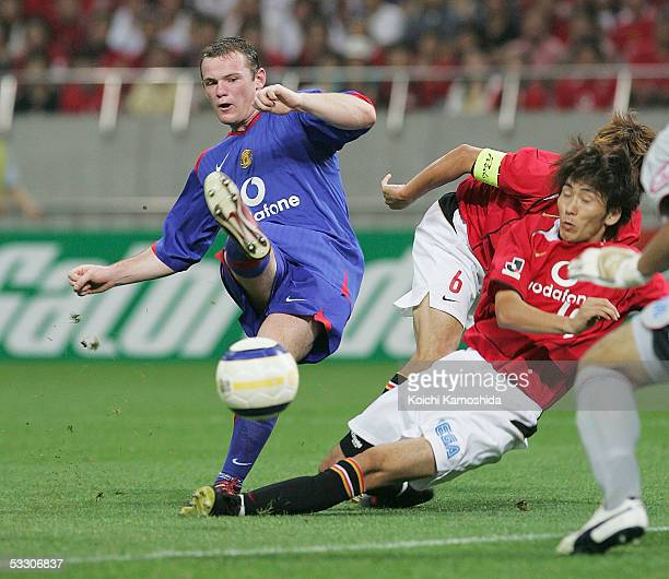 Wayne Rooney of Manchester United scores the first goal during the preseason friendly match against Urawa Reds at Saitama Stadium 2002 on July 30...