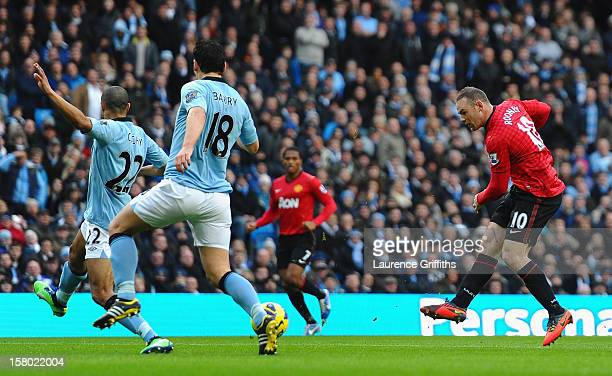 Wayne Rooney of Manchester United scores the opening goal during the Barclays Premier League match between Manchester City and Manchester United at...