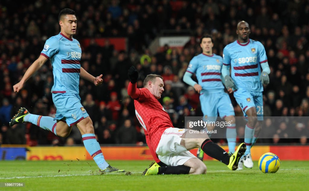 <a gi-track='captionPersonalityLinkClicked' href=/galleries/search?phrase=Wayne+Rooney&family=editorial&specificpeople=157598 ng-click='$event.stopPropagation()'>Wayne Rooney</a> of Manchester United scores the opening goal during the FA Cup with Budweiser Third Round Replay match between Manchester United and West Ham United at Old Trafford on January 16, 2013 in Manchester, England.