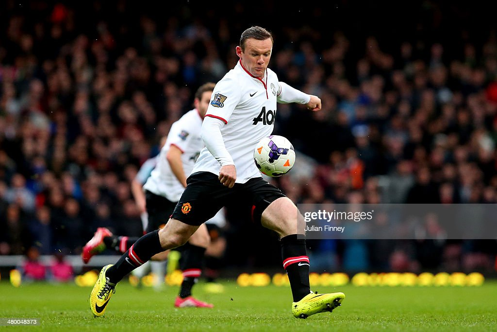 Wayne Rooney of Manchester United scores the opening goal with a long range shot during the Barclays Premier League match between West Ham United and Manchester United at Boleyn Ground on March 22, 2014 in London, England.