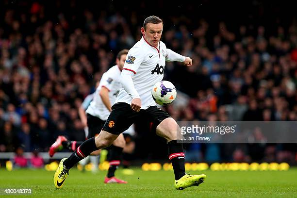 Wayne Rooney of Manchester United scores the opening goal with a long range shot during the Barclays Premier League match between West Ham United and...