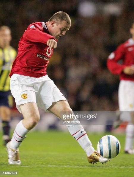 Wayne Rooney of Manchester United scores the second goal during the UEFA Champions League match between Manchester United and Fenerbahce at Old...