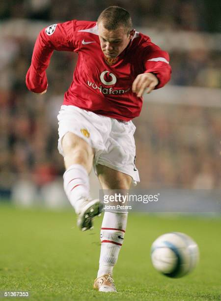 Wayne Rooney of Manchester United scores the third goal during the UEFA Champions League match between Manchester United and Fenerbahce at Old...