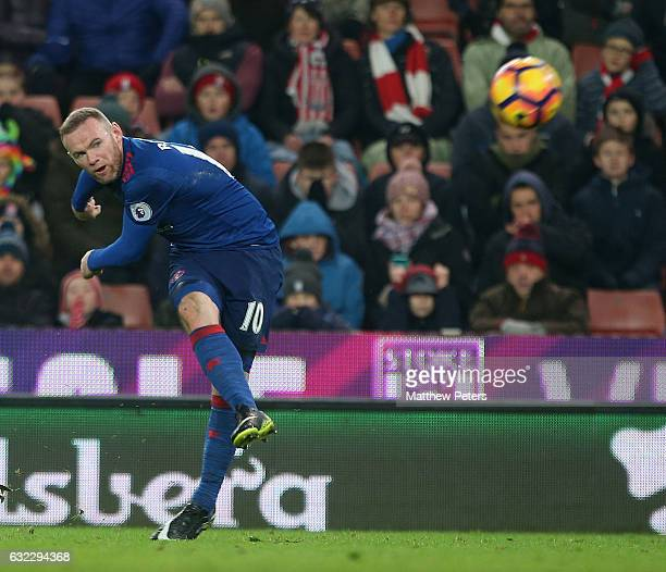 Wayne Rooney of Manchester United scores their first goal and becomes the club's record goalscorer with 250 goals during the Premier League match...