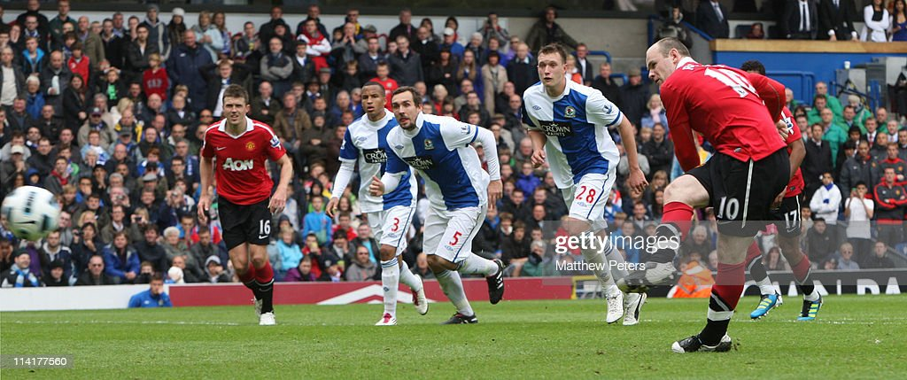 Wayne Rooney of Manchester United scores their first goal during the Barclays Premier League match between Blackburn Rovers and Manchester United at Ewood Park on May 14, 2011 in Blackburn, England.