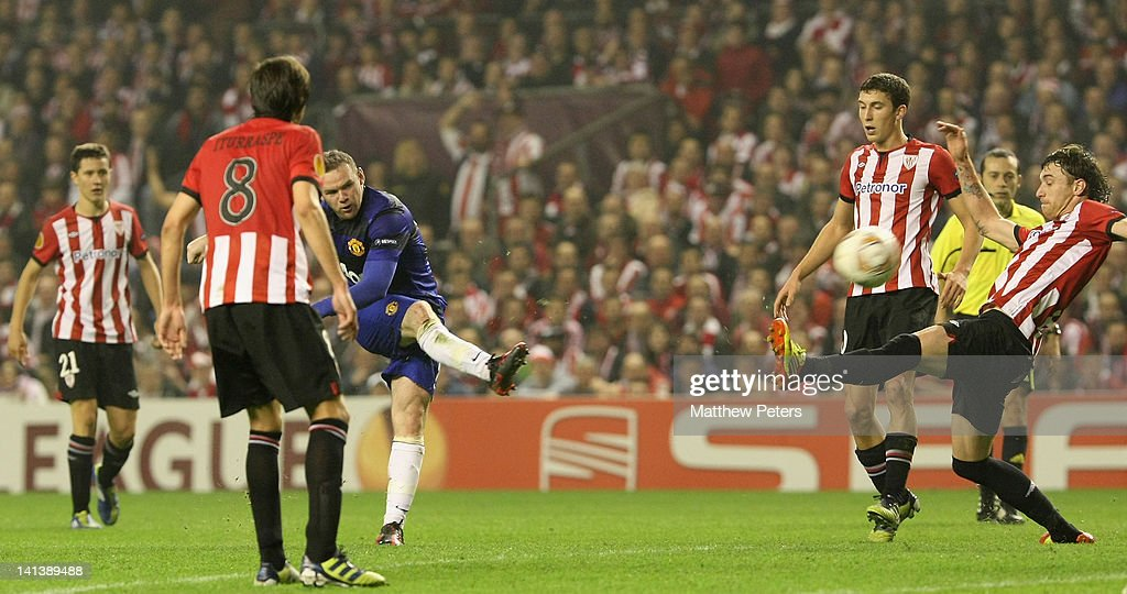 Wayne Rooney of Manchester United scores their first goal during the UEFA Europa League Round of 16 second leg match between Athletic Club of Bilbao and Manchester United at San Mames Stadium on March 15, 2012 in Bilbao, Spain.
