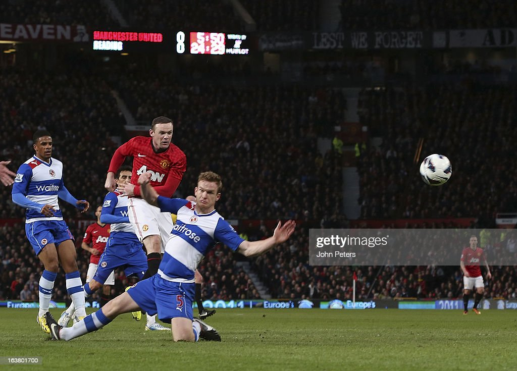 <a gi-track='captionPersonalityLinkClicked' href=/galleries/search?phrase=Wayne+Rooney&family=editorial&specificpeople=157598 ng-click='$event.stopPropagation()'>Wayne Rooney</a> of Manchester United scores their first goal during the Barclays Premier League match between Manchester United and Reading at Old Trafford on March 16, 2013 in Manchester, England.