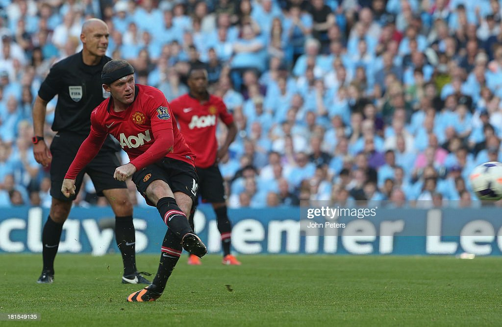 Wayne Rooney of Manchester United scores their first goal during the Barclays Premier League match between Manchester City and Manchester United at the Etihad Stadium on September 22, 2013 in Manchester, England.