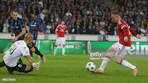 Wayne Rooney of Manchester United scores their first goal during the UEFA Champions League playoff second leg match between Club Brugge and...