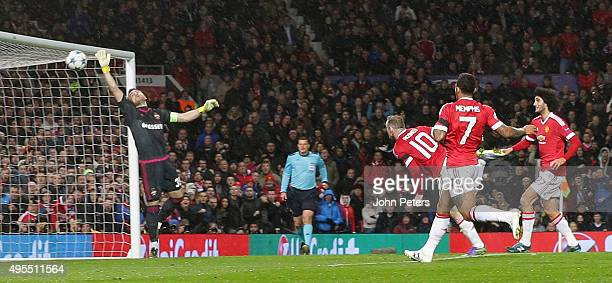 Wayne Rooney of Manchester United scores their first goal during the UEFA Champions League match between Manchester United and CSKA Moscow at Old...