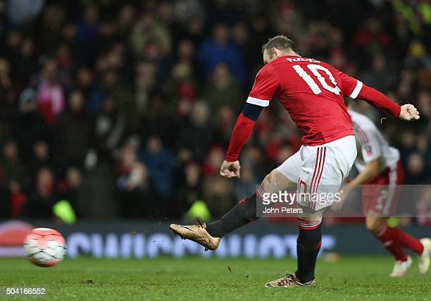 Wayne Rooney of Manchester United scores their first goal during the Emirates FA Cup Third Round match between Manchester United and Sheffield United...