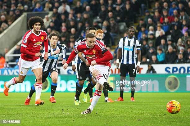 Wayne Rooney of Manchester United scores their first goal from the penalty spot during the Barclays Premier League match between Newcastle United and...