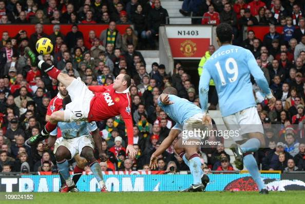 Wayne Rooney of Manchester United scores their second goal during the Barclays Premier League match between Manchester United and Manchester City at...