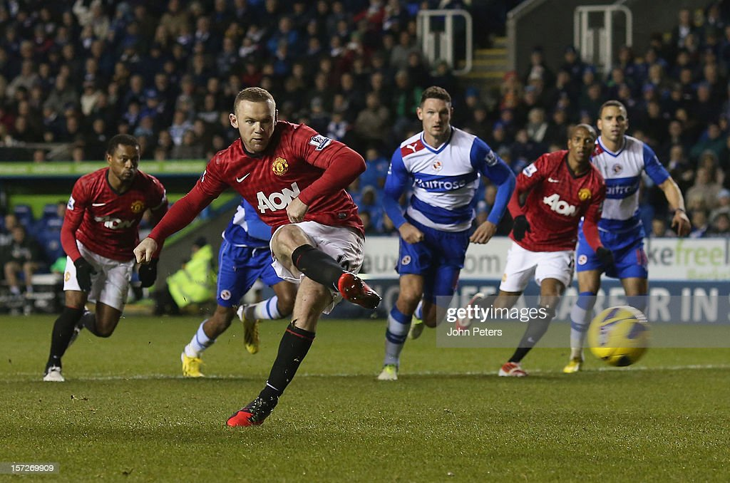 <a gi-track='captionPersonalityLinkClicked' href=/galleries/search?phrase=Wayne+Rooney&family=editorial&specificpeople=157598 ng-click='$event.stopPropagation()'>Wayne Rooney</a> of Manchester United scores their second goal during the Barclays Premier League match between Reading and Manchester United at Madejski Stadium on December 1, 2012 in Reading, England.