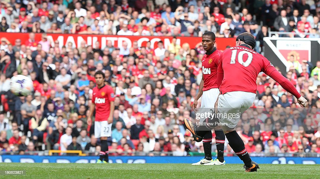 <a gi-track='captionPersonalityLinkClicked' href=/galleries/search?phrase=Wayne+Rooney&family=editorial&specificpeople=157598 ng-click='$event.stopPropagation()'>Wayne Rooney</a> of Manchester United scores their second goal during the Barclays Premier League match between Manchester United and Crystal Palace at Old Trafford on September 14, 2013 in Manchester, England.