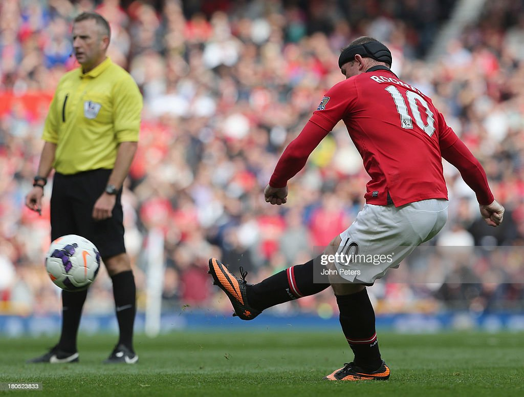 Wayne Rooney of Manchester United scores their second goal during the Barclays Premier League match between Manchester United and Crystal Palace at Old Trafford on September 14, 2013 in Manchester, England.