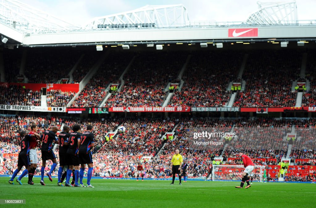 Wayne Rooney of Manchester United (R) scores their second goal from a free kick during the Barclays Premier League match between Manchester United and Crystal Palace at Old Trafford on September 14, 2013 in Manchester, England.