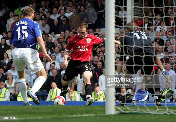 Wayne Rooney of Manchester United scores their third goal during the Barclays Premiership match between Everton and Manchester United at Goodison...