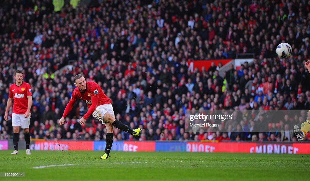 <a gi-track='captionPersonalityLinkClicked' href=/galleries/search?phrase=Wayne+Rooney&family=editorial&specificpeople=157598 ng-click='$event.stopPropagation()'>Wayne Rooney</a> of Manchester United scores to make it 4-0 during the Barclays Premier League match between Manchester United and Norwich City at Old Trafford on March 2, 2013 in Manchester, England.