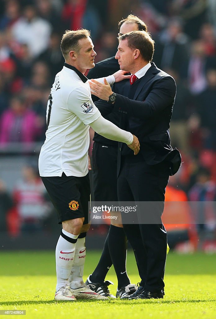 Wayne Rooney of Manchester United shakes hands with Brendan Rodgers manager of Liverpool after the Barclays Premier League match between Liverpool...
