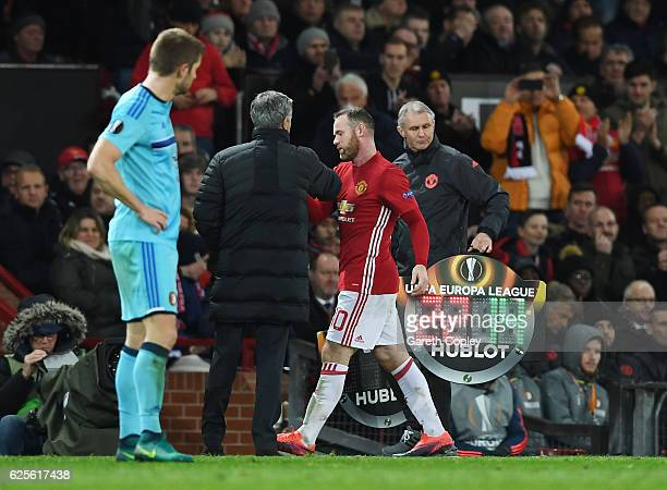 Wayne Rooney of Manchester United shakes hands with Jose Mourinho manager of Manchester United as he is substituted during the UEFA Europa League...