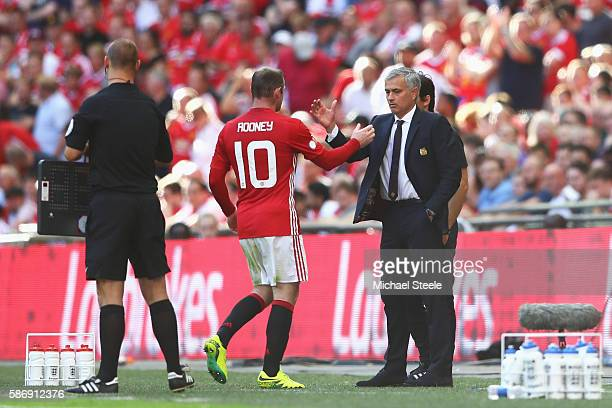 Wayne Rooney of Manchester United shakes hands with Manager of Manchester United Jose Mourinho during The FA Community Shield match between Leicester...