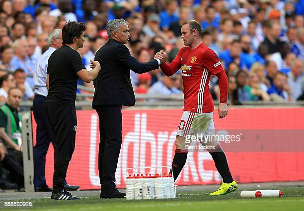 Wayne Rooney of Manchester United shakes the hand of Manchester United manager Jose Mourinho during The FA Community Shield between Leicester City...