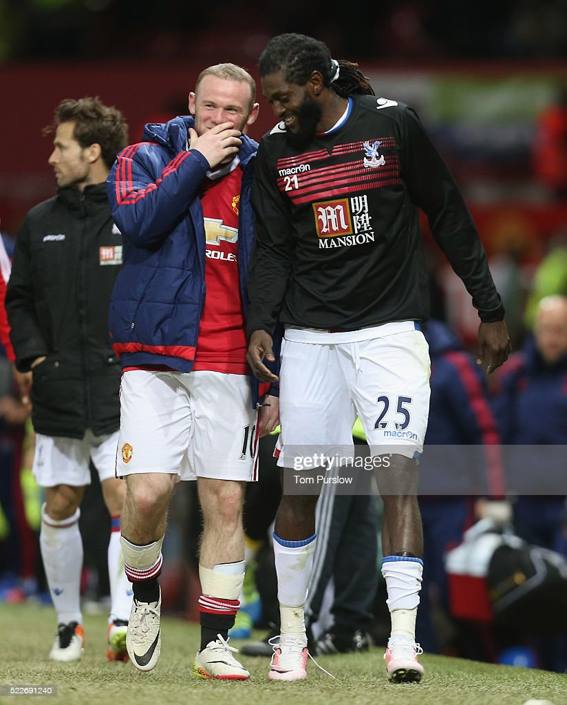Wayne Rooney of Manchester United shares a joke with Emmanuel Adebayor of Crystal Palace after the Barclays Premier League match between Manchester United and Crystal Palace at Old Trafford on April 20, 2016 in Manchester, England.