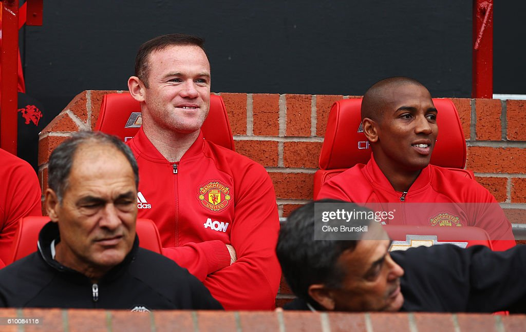 Wayne Rooney of Manchester United (L) shares a smile with Ashley Young of Manchester United (R) while sitting on the bench during the Premier League match between Manchester United and Leicester City at Old Trafford on September 24, 2016 in Manchester, England.