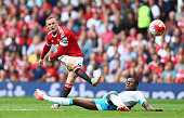 Wayne Rooney of Manchester United shoots at goal during the Barclays Premier League match between Manchester United and Newcastle United at Old...