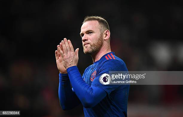 Wayne Rooney of Manchester United shows appreciation to the fans after the Premier League match between Stoke City and Manchester United at Bet365...