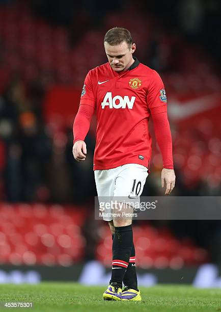 Wayne Rooney of Manchester United shows his disappointment after the Barclays Premier League match between Manchester United and Everton at Old...