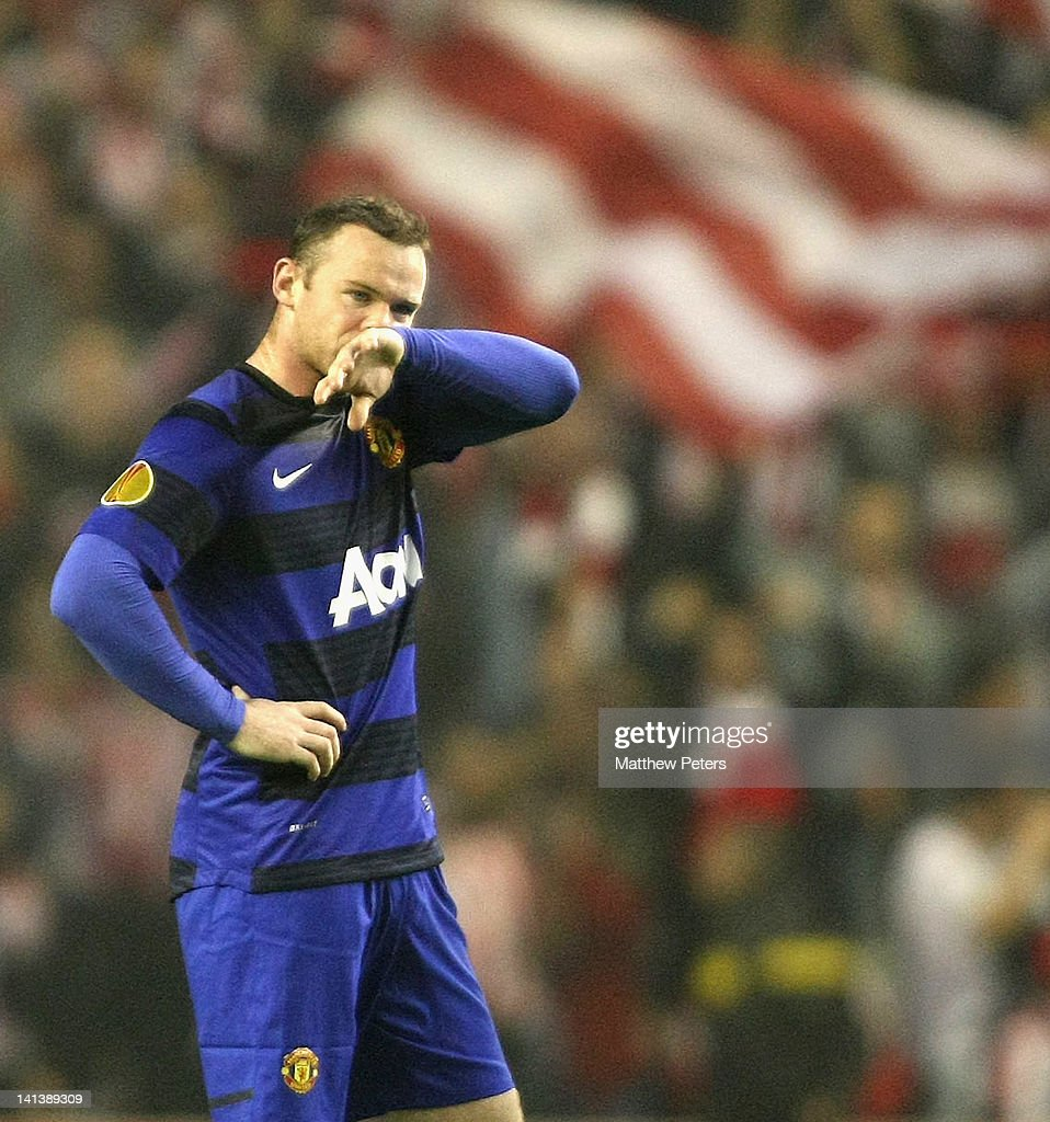 Wayne Rooney of Manchester United shows his disappointment during the UEFA Europa League Round of 16 second leg match between Athletic Club of Bilbao and Manchester United at San Mames Stadium on March 15, 2012 in Bilbao, Spain.