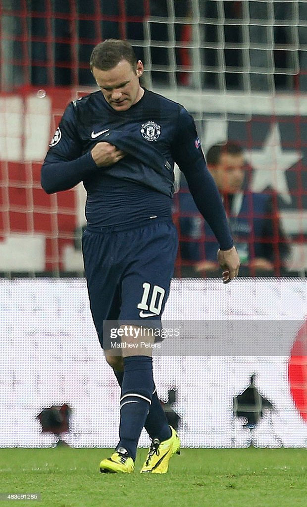 Wayne Rooney of Manchester United shows his disappointment during the UEFA Champions League quarter-final second leg match between Bayern Munich and Manchester United at Allianz Arena on April 9, 2014 in Munich, Germany.