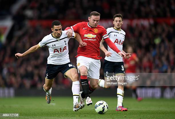 Wayne Rooney of Manchester United shrugs off the challenge from Nabil Bentaleb of Spurs during the Barclays Premier League match between Manchester...