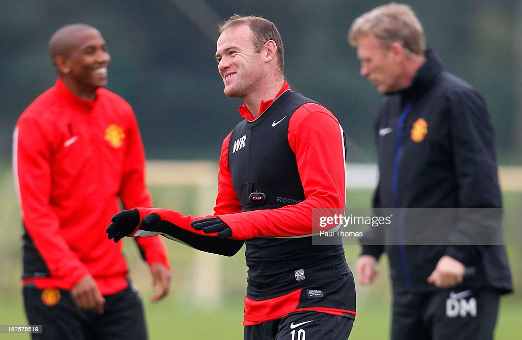 <a gi-track='captionPersonalityLinkClicked' href=/galleries/search?phrase=Wayne+Rooney&family=editorial&specificpeople=157598 ng-click='$event.stopPropagation()'>Wayne Rooney</a> (C) of Manchester United smiles during a training session ahead of their Champions League Group A match against Shakhtar Donetsk at their Carrington Training Complex on October 01, 2013 in Manchester, England