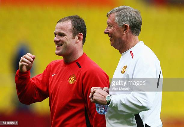 Wayne Rooney of Manchester United smiles with manager Sir Alex Ferguson during the Manchester United training session ahead of the Champions League...
