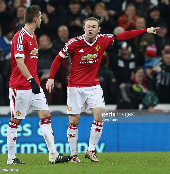 Wayne Rooney of Manchester United speaks to Morgan Schneiderlin after conceding a goal to Aleksandar Mitrovic during the Barclays Premier League...