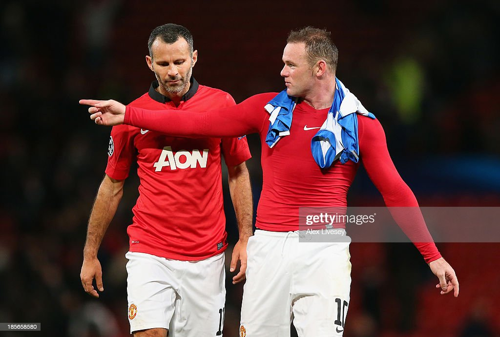 <a gi-track='captionPersonalityLinkClicked' href=/galleries/search?phrase=Wayne+Rooney&family=editorial&specificpeople=157598 ng-click='$event.stopPropagation()'>Wayne Rooney</a> of Manchester United speaks to team-mate <a gi-track='captionPersonalityLinkClicked' href=/galleries/search?phrase=Ryan+Giggs&family=editorial&specificpeople=201666 ng-click='$event.stopPropagation()'>Ryan Giggs</a> (L) at the end of the UEFA Champions League Group A match between Manchester United and Real Sociedad at Old Trafford on October 23, 2013 in Manchester, England.