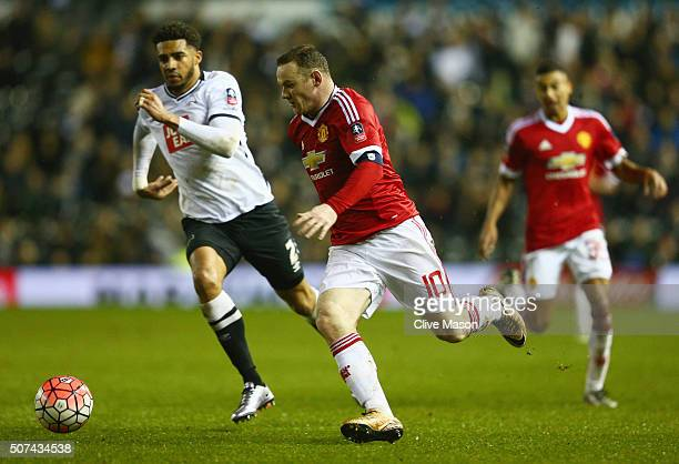 Wayne Rooney of Manchester United takes on Cyrus Christie of Derby County during the Emirates FA Cup fourth round match between Derby County and...