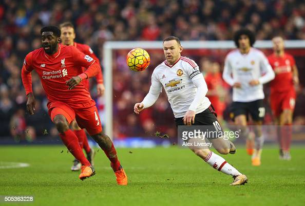 Wayne Rooney of Manchester United takes on Kolo Toure of Liverpool during the Barclays Premier League match between Liverpool and Manchester United...