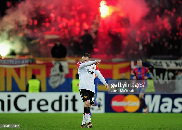 Wayne Rooney of Manchester United walks dejected after Basel scored their second goal during the UEFA Champions League Group C match between FC Basel...
