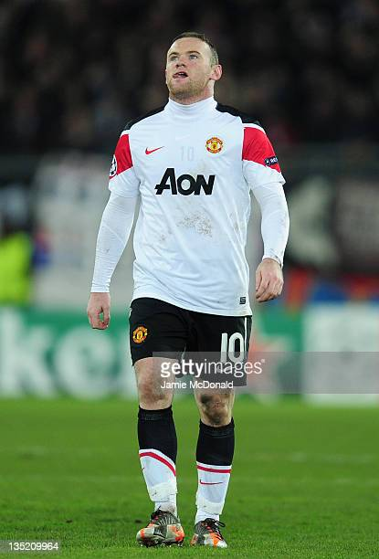 Wayne Rooney of Manchester United walks dejected after defeat in the UEFA Champions League Group C match between FC Basel 1893 and Manchester United...