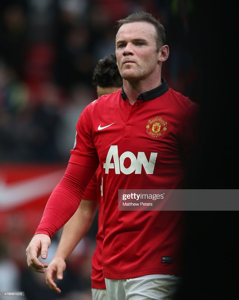 <a gi-track='captionPersonalityLinkClicked' href=/galleries/search?phrase=Wayne+Rooney&family=editorial&specificpeople=157598 ng-click='$event.stopPropagation()'>Wayne Rooney</a> of Manchester United walks off after the Barclays Premier League match between Manchester United and Liverpool at Old Trafford on March 16, 2014 in Manchester, England.